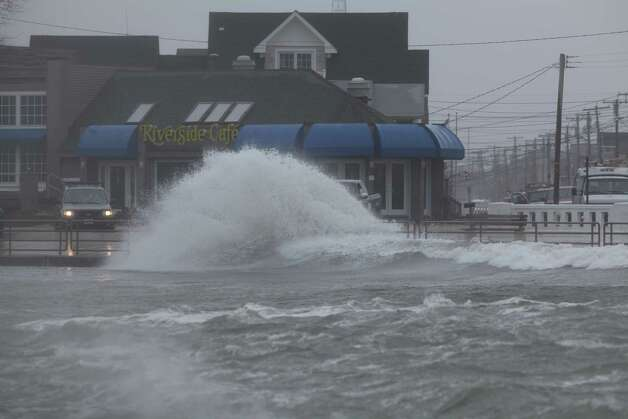 Wind, rain and the tide batter the Jersey Shore as a winter storm moves at the Point Pleasant inlet in Manasquan, N.J. (AP Photo/The Record of Bergen County, Chris Pedota) Photo: Chris Pedota
