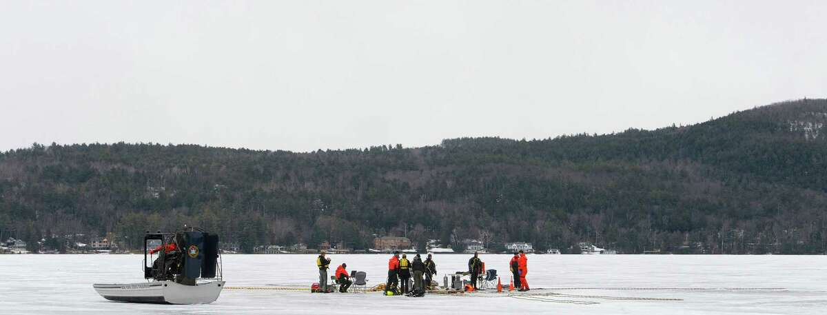 New York State Police and Delaware State Police divers go through training exercises on Lake George on Thursday, March 7, 2013 in Lake George, NY. (Paul Buckowski / Times Union)