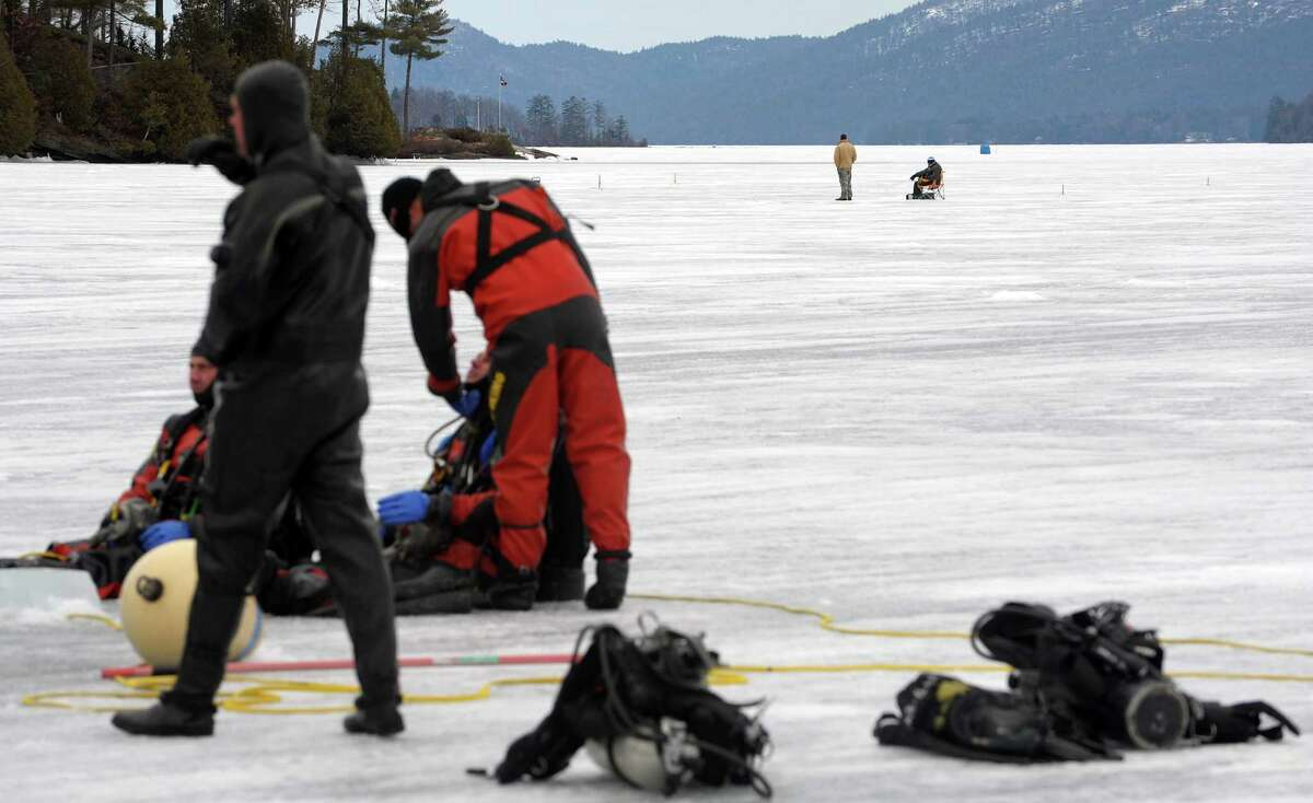 Ice fishermen are seen in the background as New York State Police and Delaware State Police divers went through training exercises on Lake George on Thursday, March 7, 2013 in Lake George, NY. (Paul Buckowski / Times Union)