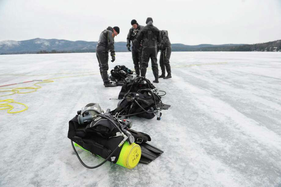 New York State Police Troopers wait for their turn to go under water as New York State Police and Delaware State Police divers went through training exercises on Lake George on Thursday, March 7, 2013 in Lake George, NY.    (Paul Buckowski / Times Union) Photo: Paul Buckowski
