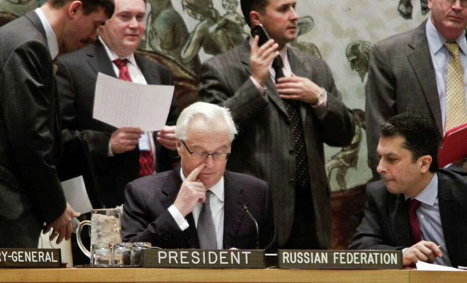 Russia's UN Ambassador Vitaly Churkin, center, current president for the U.N. Security Council, confers before leading council members on a vote for tough new sanctions against North Korea for its latest nuclear test, during a meeting at U.N. headquarters Thursday, March 7, 2013. The unanimous vote by the U.N.'s most powerful body sparked a furious Pyongyang to threaten a nuclear strike against the United States. (AP Photo/Bebeto Matthews) Photo: Bebeto Matthews