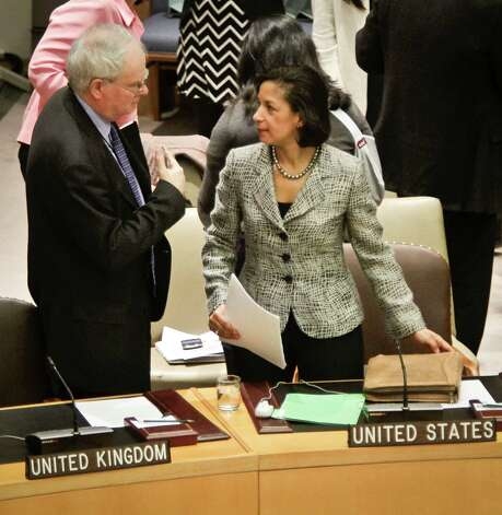 U.K. Ambassador Mark Lyall, left, and U.S. Ambassador Susan Rice confer before members of the United Nations Security Council vote for tough new sanctions against North Korea for its latest nuclear test, during a meeting at U.N. headquarters Thursday, March 7, 2013. The unanimous vote by the U.N.'s most powerful body sparked a furious Pyongyang to threaten a nuclear strike against the United States. (AP Photo/Bebeto Matthews) Photo: Bebeto Matthews