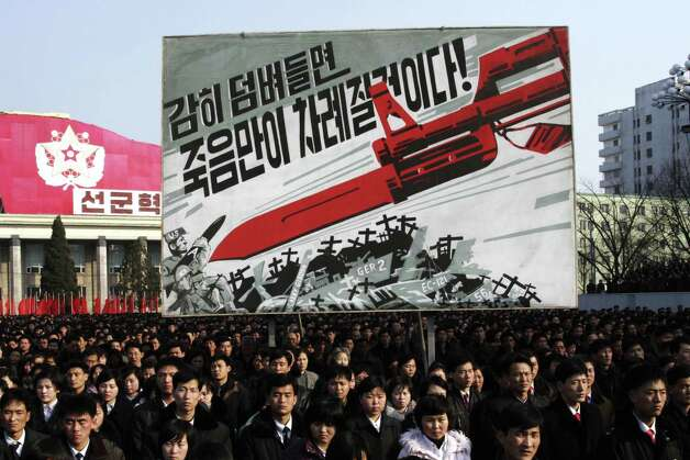 "North Koreans attend a rally to support a statement given on Tuesday by a spokesman for the Supreme Command of the Korean People's Army vowing to cancel the 1953 cease-fire that ended the Korean War as well as boasting of the North's ownership of ""lighter and smaller nukes"" and its ability to execute ""surgical strikes""  meant to unify the divided Korean Peninsula, at Kim Il Sung Square in Pyongyang, North Korea, on Thursday, March 7, 2013. North Korea on Thursday vowed to launch a pre-emptive nuclear strike against the United States, amplifying its threatening rhetoric hours ahead of a vote by U.N. diplomats on whether to level new sanctions against Pyongyang for its recent nuclear test. The billboard in background depicts a large bayonet pointing at U.S. army soldiers with writing reading ""If you dare invade, only death will be waiting for you!"" (AP Photo/Jon Chol Jin) Photo: Jon Chol Jin"