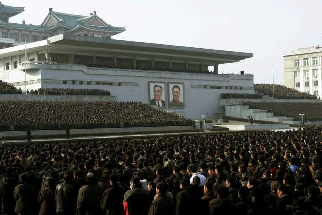 "North Koreans attend a rally in support of a statement given on Tuesday by a spokesman for the Supreme Command of the Korean People's Army vowing to cancel the 1953 cease-fire that ended the Korean War as well as boasting of the North's ownership of ""lighter and smaller nukes"" and its ability to execute ""surgical strikes""  meant to unify the divided Korean Peninsula, at Kim Il Sung Square in Pyongyang, North Korea, on Thursday, March 7, 2013. North Korea on Thursday vowed to launch a pre-emptive nuclear strike against the United States, amplifying its threatening rhetoric hours ahead of a vote by U.N. diplomats on whether to level new sanctions against Pyongyang for its recent nuclear test. (AP Photo/Jon Chol Jin) Photo: Jon Chol Jin"