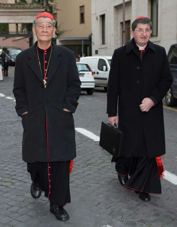 Vietnamese Cardinal Jean-Baptiste Pham Minh Man, left, and cardinal Giuseppe Betori arrive for a meeting, at the Vatican, Thursday, March 7, 2013. The cardinals didn't set a date for the start of the conclave, and the Vatican spokesman, the Rev. Federico Lombardi, said he didn't expect a decision to be taken in Thursday's afternoon session. The last of the 115 voting-age cardinals, Vietnamese Cardinal Jean-Baptiste Pham Minh Man, arrived later Thursday and the date can't be set until he does. (AP Photo/Andrew Medichini) Photo: Andrew Medichini