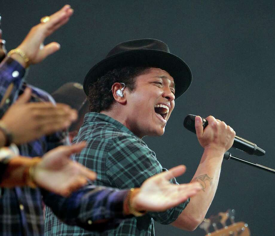 Bruno Mars was a big crowd-pleaser and drew a record-breaking 75,175 fans. Photo: James Nielsen, Staff / © 2013  Houston Chronicle