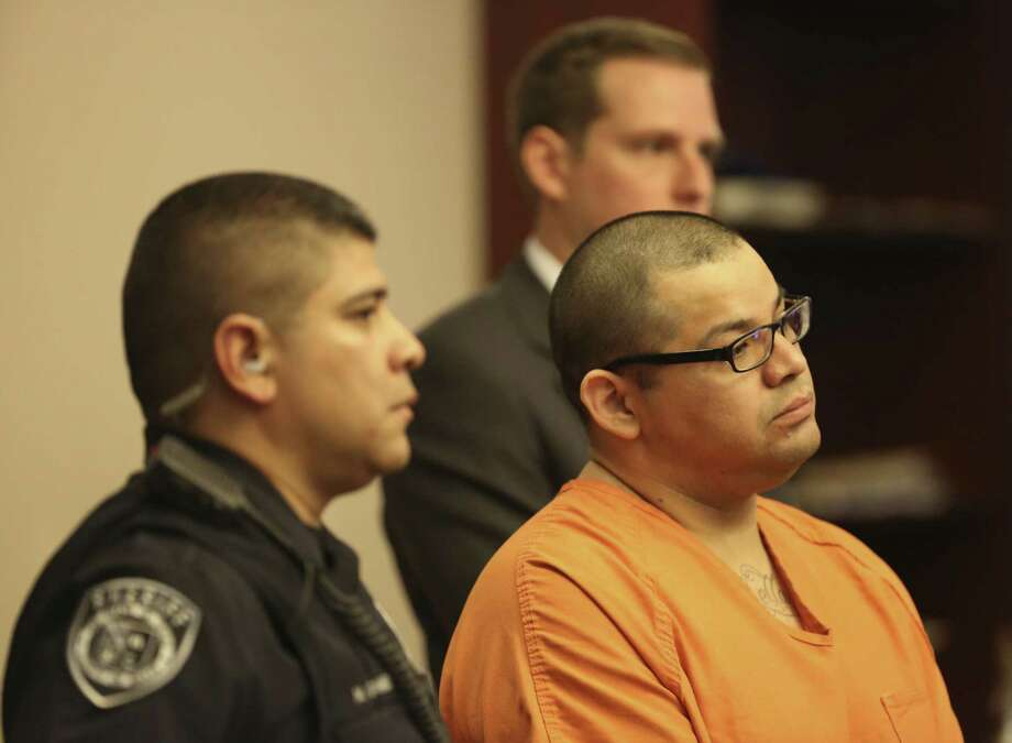 Gabriel Reyes Castillo (right) is sentenced to 45 years in prison for kicking in the door to his former girlfriend's apartment and then using a shovel to beat to death the man who was with her. Photo: Helen L. Montoya / San Antonio Express-News