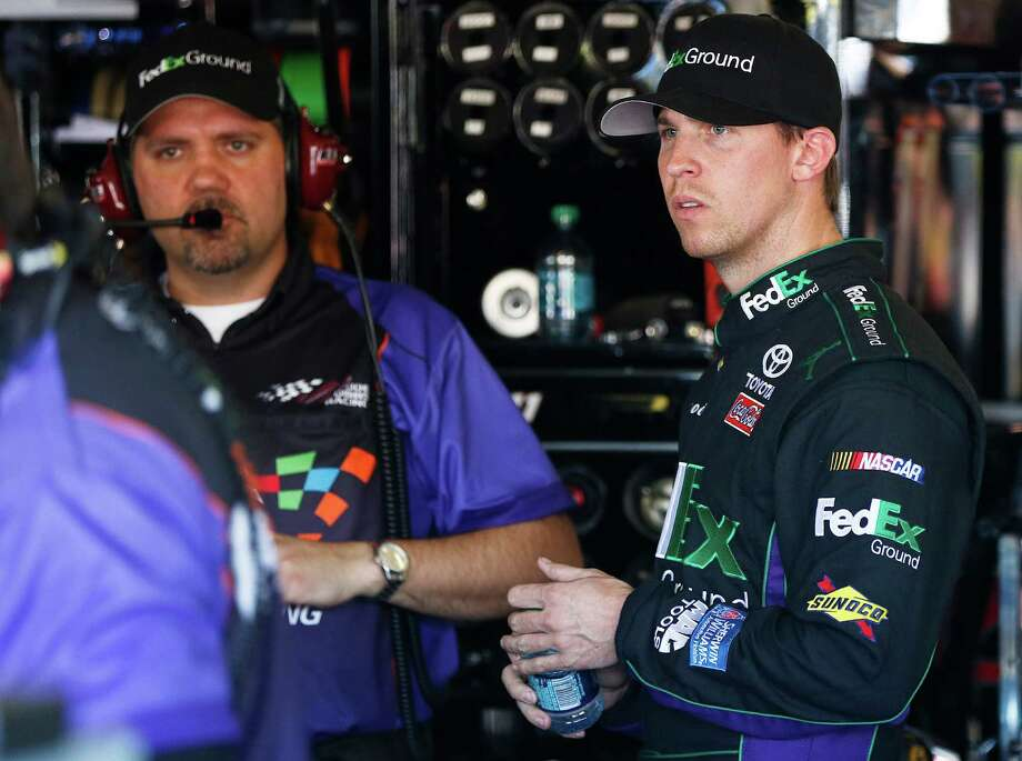 Denny Hamlin, right, meets with crew chief Darian Grubb in the team garage during practice for the NASCAR Sprint Cup Series auto race Saturday, March 2, 2013, in Avondale, Ariz.(AP Photo/Ross D. Franklin) Photo: Ross D. Franklin