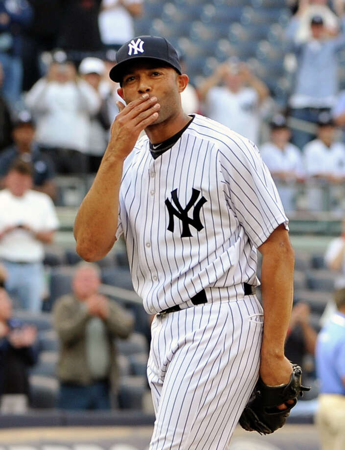 FILE - In this Sept. 19, 2011 file photo, New York Yankees' Mariano Rivera blows a kiss to the crowd to acknowledge cheers after recording his 602nd save as the Yankees beat the Minnesota Twins 6-4 in a baseball game at Yankee Stadium in New York. A person familiar with the decision says that  Rivera plans to retire after the 2013 season. The person spoke to The Associated Press on Thursday, March 7, 2013,  on condition of anonymity because there had been no official announcement. (AP Photo/Kathy Kmonicek, File) Photo: Kathy Kmonicek
