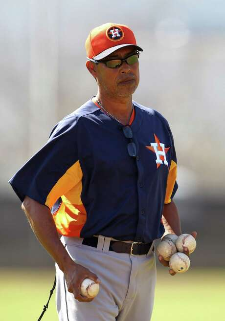 New Astros bullpen coach Dennis Martinez has his hands full trying to mold a young staff into the type of accomplished pitcher he was in 23 major league seasons. Photo: Karen Warren, Staff / © 2013 Houston Chronicle