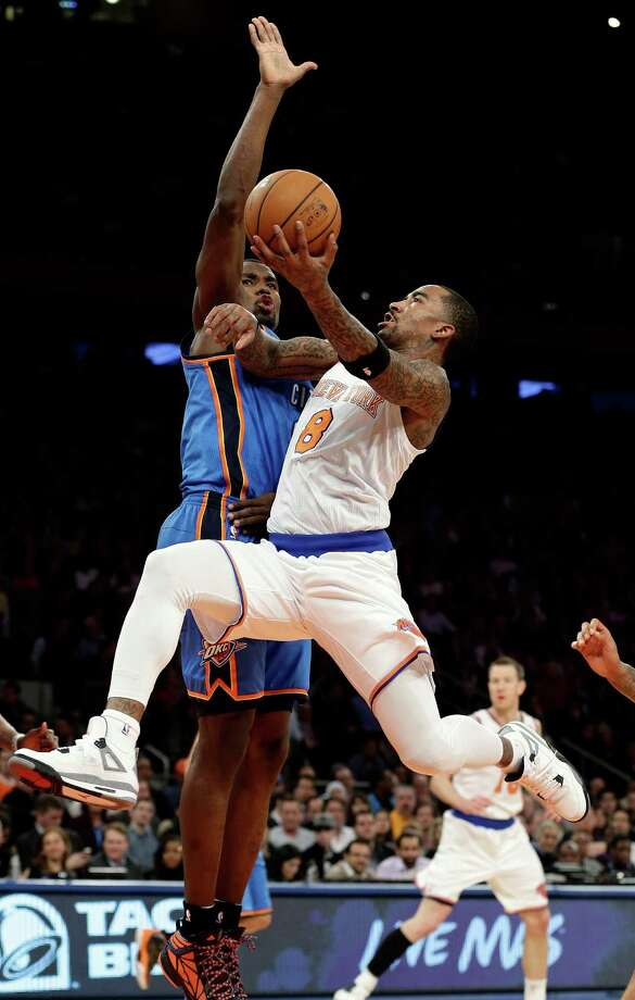 New York Knicks' J.R. Smith (8) drives past Oklahoma City Thunder's Serge Ibaka during the first half of an NBA basketball game Thursday, March 7, 2013, in New York.  (AP Photo/Frank Franklin II) Photo: Frank Franklin II
