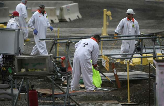 Workers are shown in a contaminated area at C-Tank Farm during a tour of the Hanford