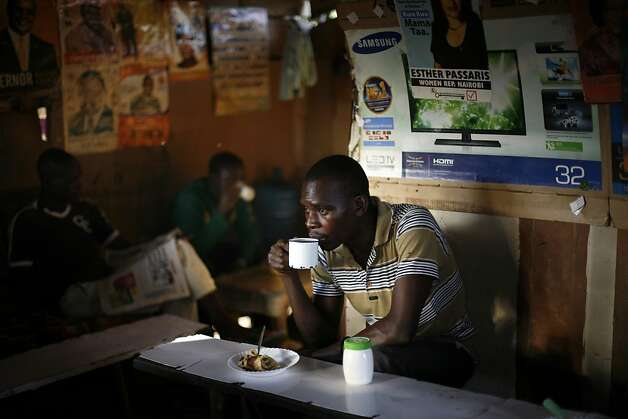 "A man drinks coffee in  the Kibera slum of Nairobi, Kenya, Thursday, March 7, 2013. Kenyans on Monday held their first presidential vote since the nation's disputed election in 2007 spawned violence that killed more than 1,000 people. The coalition of Kenya's prime minister Raila Odinga says the vote tallying process now under way to determine the winner of the country's presidential election ""lacks integrity"", should be stopped, and the counting process should be restarted using primary documents from polling stations. (AP Photo/Jerome Delay) Photo: Jerome Delay, Associated Press"
