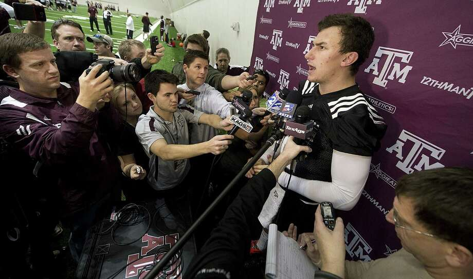 A&M QB Johnny Manziel (right) has a new offensive coordinator, but the Aggies don't expect a whole lot of changes on the field. Photo: Stuart Villanueva / Bryan-College Station Eagle