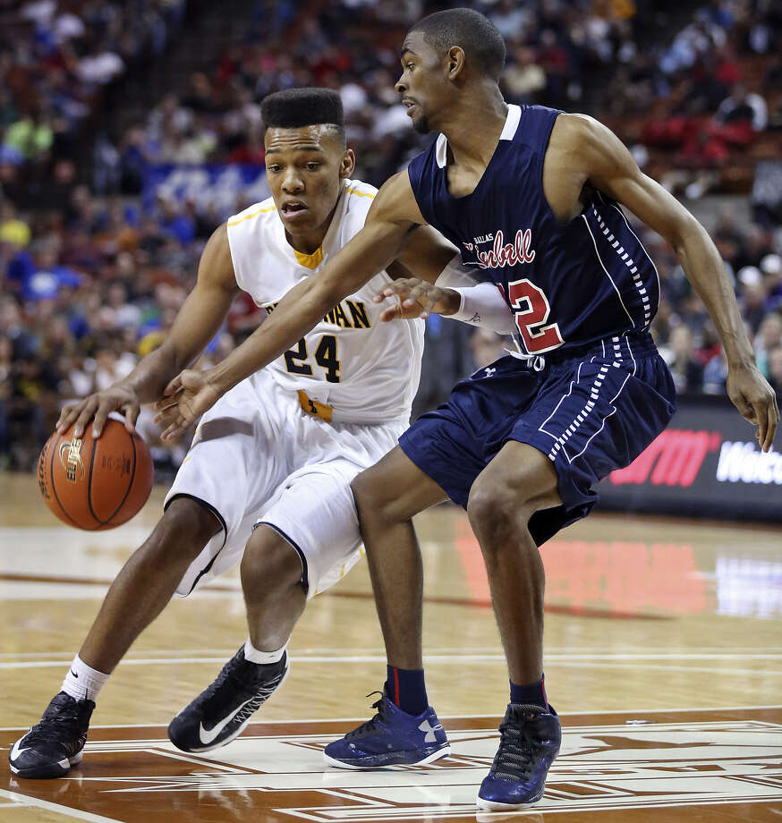 Brennan's George King (left) tries to drive around Dallas Kimball's Randelle Jones in the first half of their Class 4A state semifinal Thursday in Austin. Kimball would go on to win 64-52. Photo: Edward A. Ornelas / San Antonio Express-News