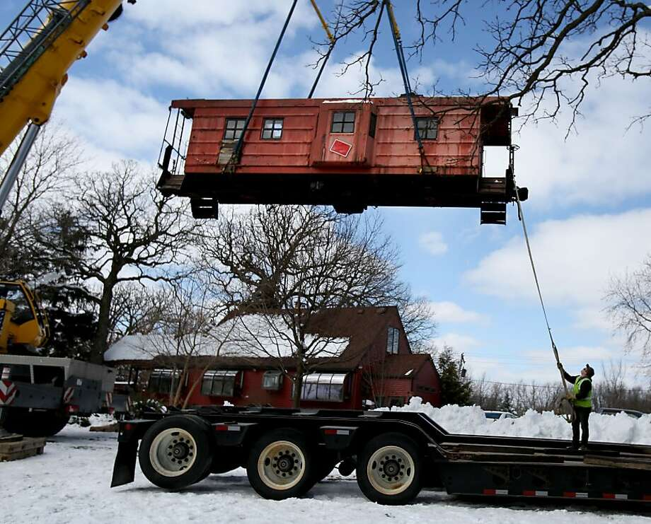 A caboose is lifted onto a flatbed truck as it was moved from its home on Bloomingdale Road for a new home at the Itasca Depot Museum in Itasca, Ill. on Thursday, March 7, 2013. (AP Photo/Daily Herald, Bev Horne) MANDATORY CREDIT; MAGS OUT; TV OUT Photo: Bev Horne, Associated Press