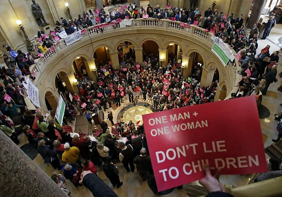 Opponents of a bill to legalize gay marriage in Minnesota gathered in the State Capitol Rotunda  to voice their opposition Thursday, March 7, 2013, in St. Paul, Minn. (AP Photo/Jim Mone) Photo: Jim Mone, Associated Press