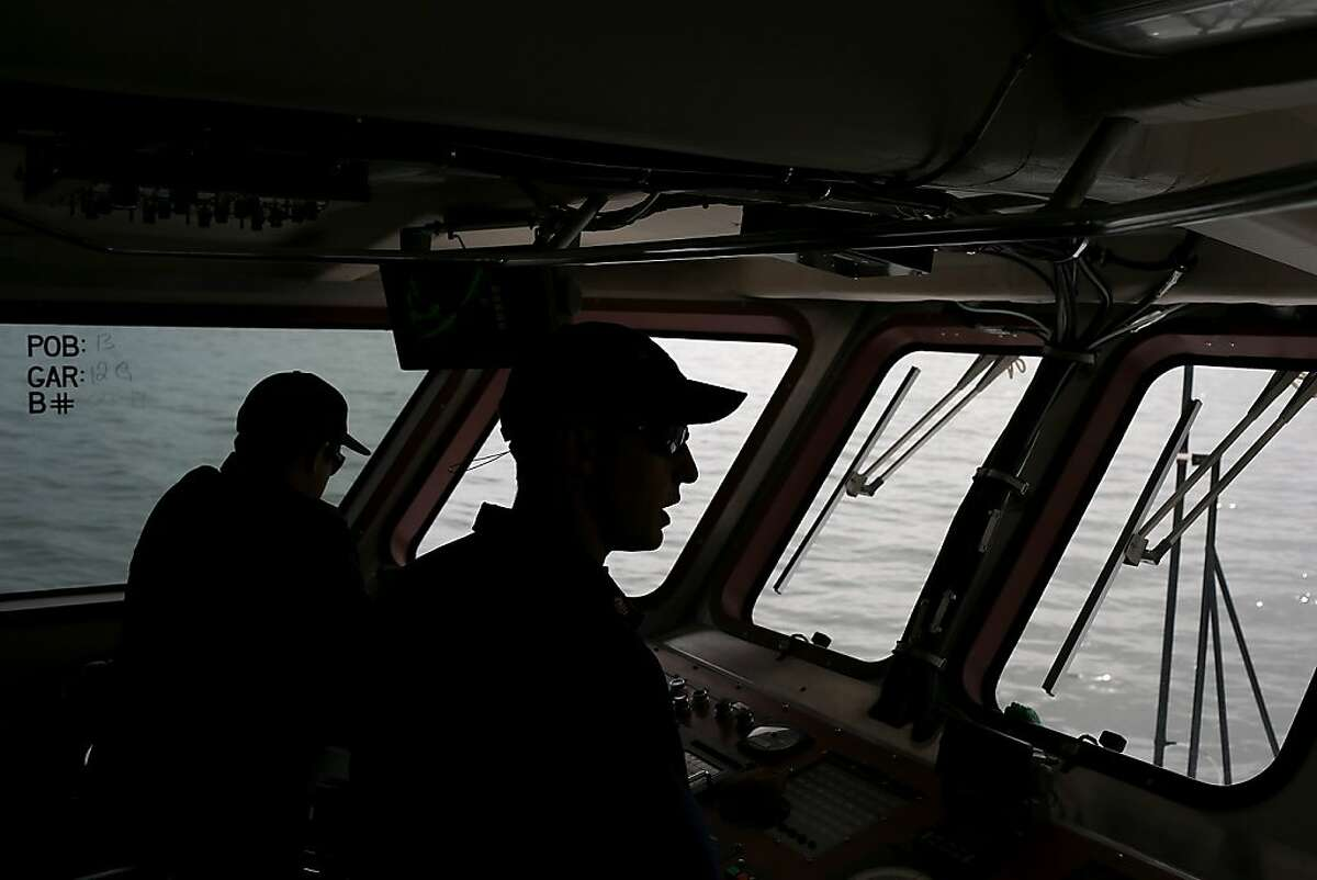 In this file photo, U.S. Coast Guard petty officer Jonathan Harrington of the U.S. Coast Guard Cutter Hawksbill stands on the bridge while on patrol in the San Francisco Bay on March 7, 2013 in San Francisco, California.