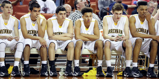 Members of the Brennan Bears sit on the bench late in their Class 4A state semifinal game with Dallas Kimball Thursday March 7, 2013 at the Frank Erwin Center in Austin, Tx. Dallas Kimball won 64-52. Photo: Edward A. Ornelas, Edward A. Ornelas / San Antonio Express-News / © 2013 San Antonio Express-News