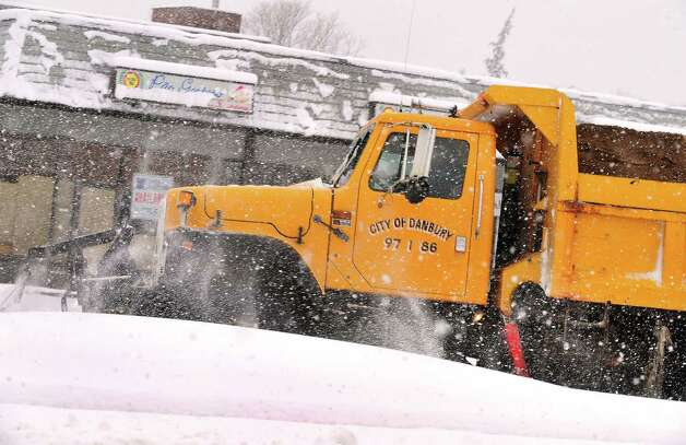 Danbury plows face an uphill battle as they help residents dig out during Friday morning's snow, in Conn. March 8, 2013. Photo: Michael Duffy / The News-Times