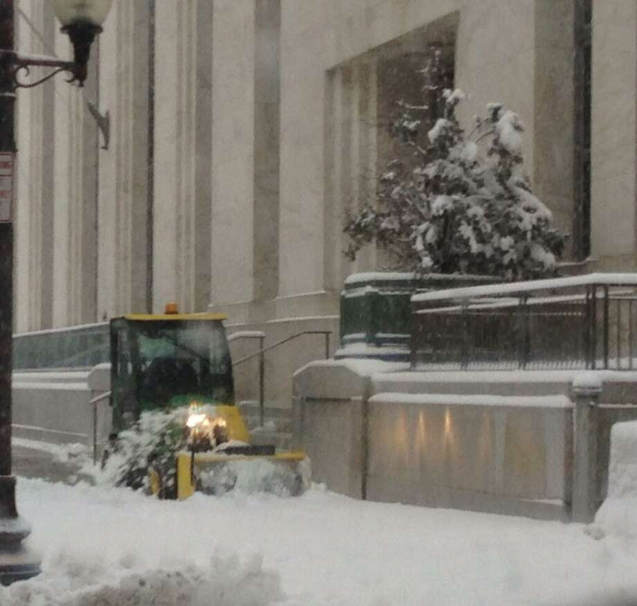 Snow is cleared from the entrance of the U.S. District Court house in Albany. (Skip Dickstein / Times Union)
