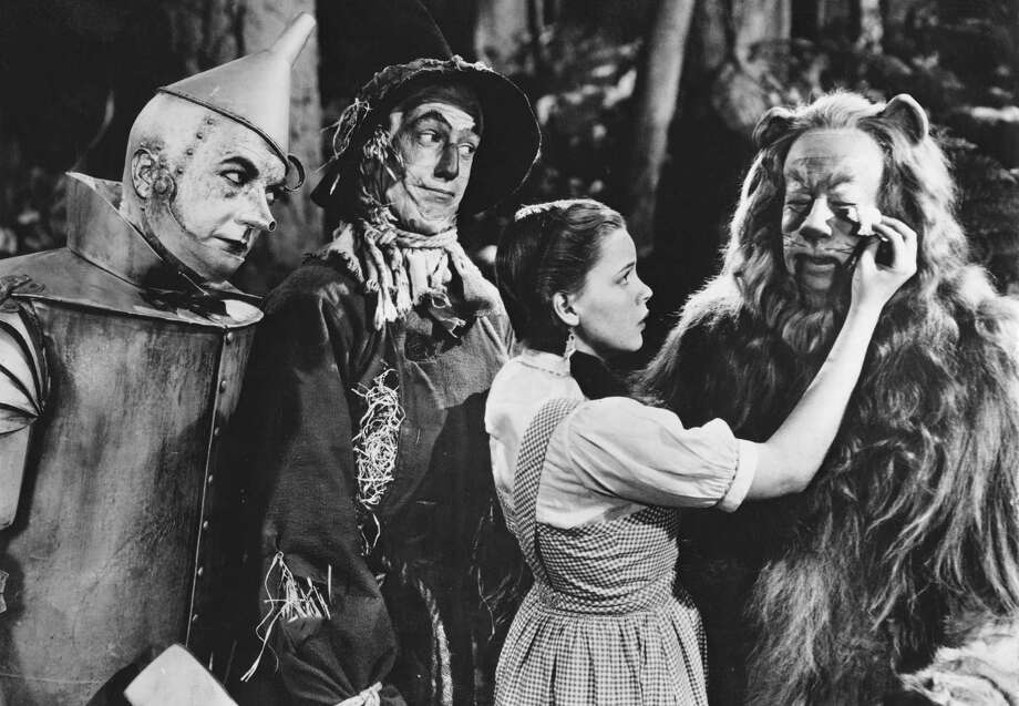 "From left to right, Jack Haley as the Tin Man, Ray Bolger as the Scarecrow, Judy Garland as Dorothy and Bert Lahr as the Cowardly Lion in the MGM film ""The Wizard of Oz,"" 1939. Photo: Authenticated News, Getty Images / 2009 Getty Images"