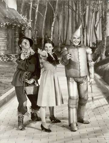 Ray Bolger, Judy Garland and Jack Haley as the Scarecrow, Dorothy, and the Tin Woodsman, respectively, in a promotional still from the film. Photo: MGM Studios, Getty Images / Moviepix