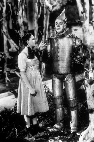 "Dorothy and the Tin Man, seen here in a still from the film ""The Wizard Of Oz,"" directed by Victor Fleming for MGM. Photo: Hulton Archive, Getty Images / Moviepix"