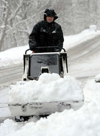 Brian Williams of Bethel, plows the driveway of the Shepherd Hill Condominiums in Danbury, Conn. Friday, March 8, 2013 after an overnight snowfall. Photo: Carol Kaliff / The News-Times