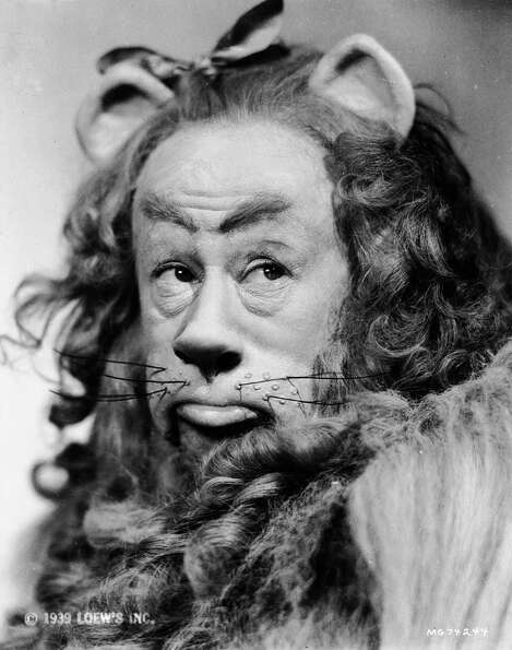 Bert Lahr in costume as the cowardly lion in the musical