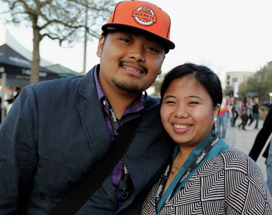 Rey Huliganga left, and Maria Sarno arrive at Reliant Park for the RodeoHouston performance featuring Bruno Mars Thursday, March 7, 2013, in Houston. Photo: James Nielsen, Houston Chronicle / © 2013  Houston Chronicle
