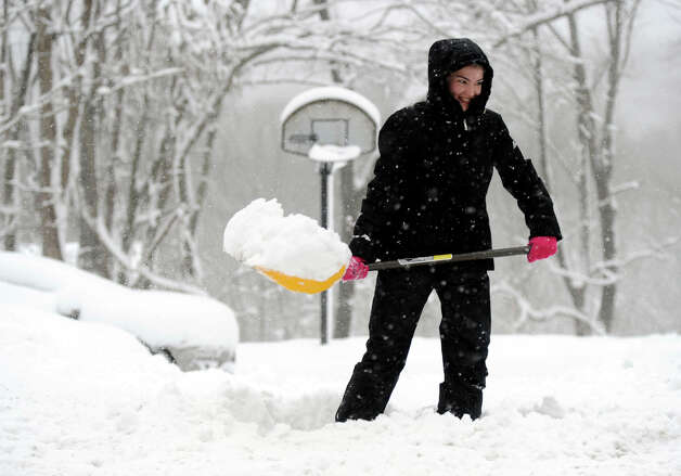Malena Bereyra of Brookfield, shovels her driveway on Candlewood Lake Rd, after an over night snowfall, Friday, March 8, 2013. Photo: Carol Kaliff / The News-Times