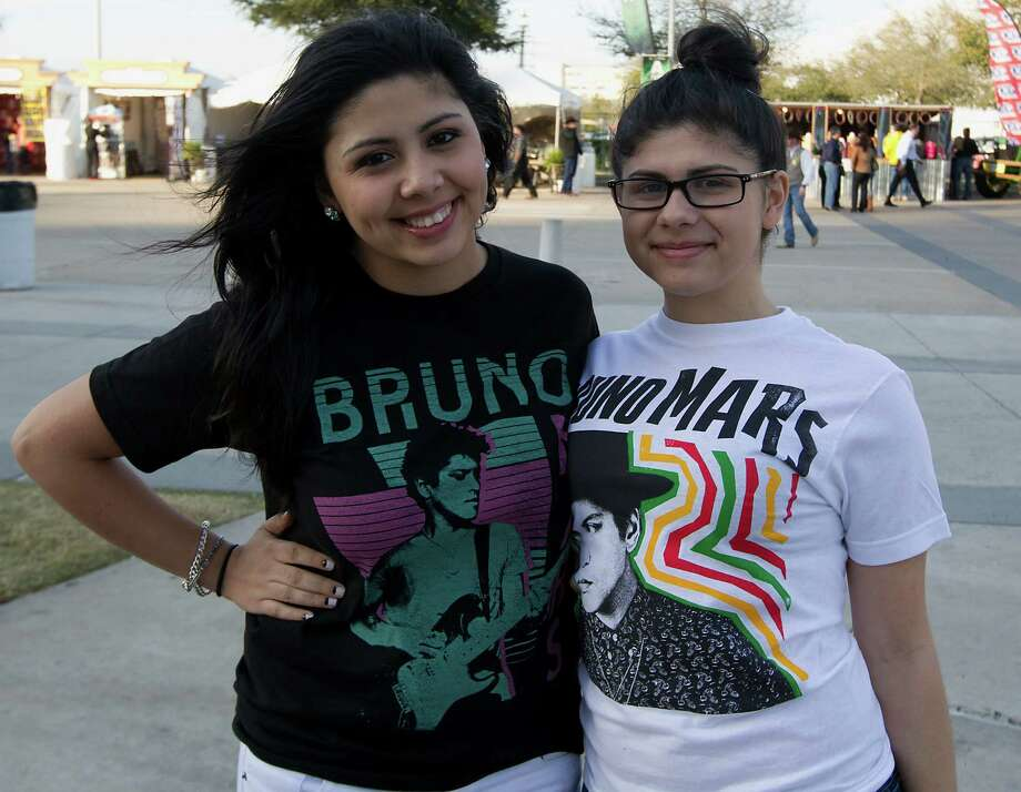 Amanda Lopez left, and her sixteen-year-old sister Autumn Lopez pose for a photograph at Reliant Park for the RodeoHouston performance featuring Bruno Mars Thursday, March 7, 2013, in Houston. Photo: James Nielsen, Houston Chronicle / © 2013  Houston Chronicle
