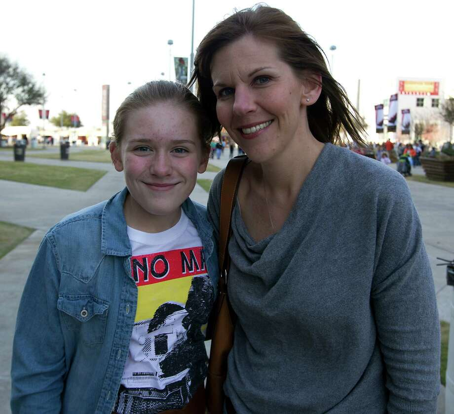 Twelve-year-old Carli Smith left, and her mother Megan Smith arrive at Reliant Park for the RodeoHouston performance featuring Bruno Mars Thursday, March 7, 2013, in Houston. Photo: James Nielsen, Houston Chronicle / © 2013  Houston Chronicle