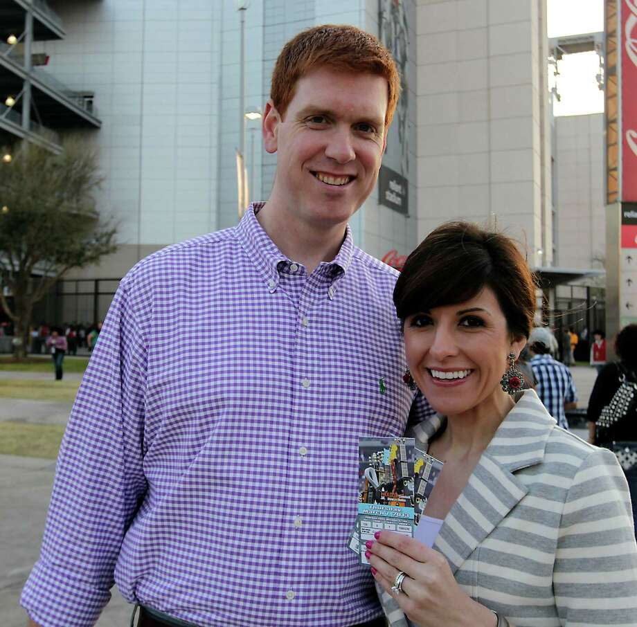 Mike O'Donnell left, and his wife Vanessa O'Donnell arrive at Reliant Park for the RodeoHouston performance featuring Bruno Mars Thursday, March 7, 2013, in Houston. Photo: James Nielsen, Houston Chronicle / © 2013  Houston Chronicle