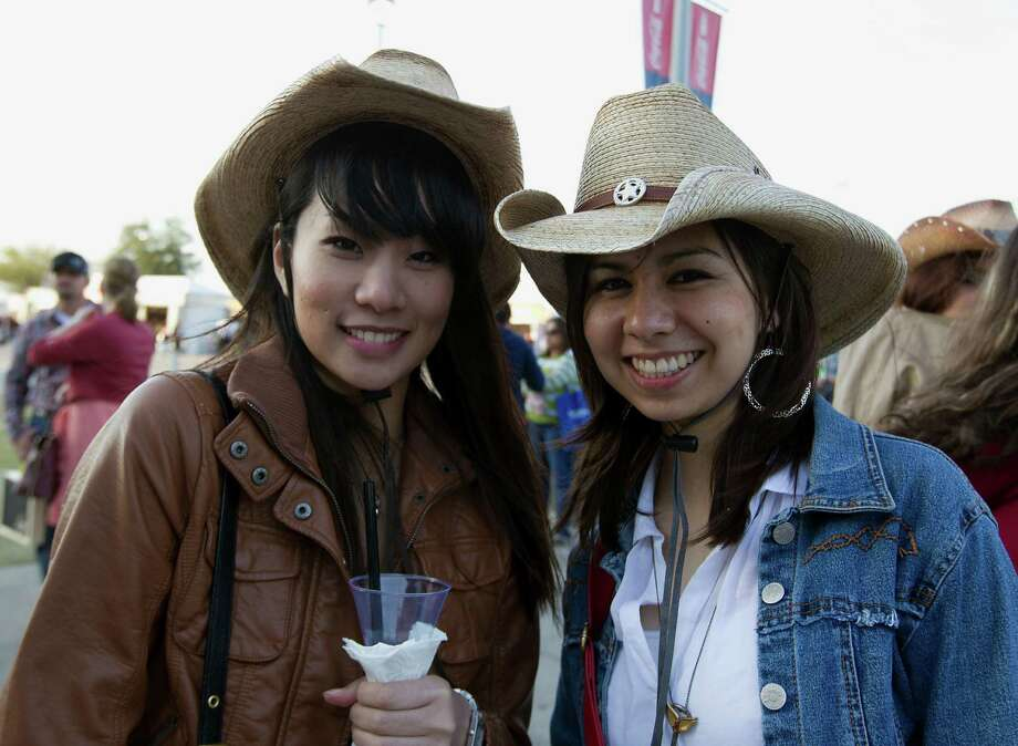 Gloria Li left, and Alexandra Martinez arrive at Reliant Park for the RodeoHouston performance featuring Bruno Mars Thursday, March 7, 2013, in Houston. Photo: James Nielsen, Houston Chronicle / © 2013  Houston Chronicle