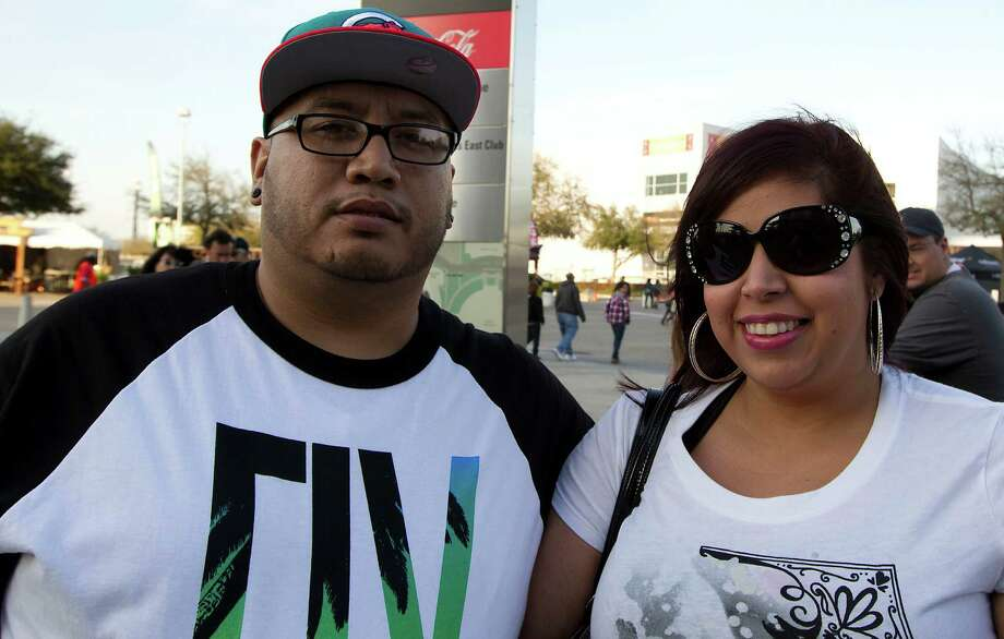 Jason Martinez left, and Amanda Ramos arrive at Reliant Park for the RodeoHouston performance featuring Bruno Mars Thursday, March 7, 2013, in Houston. Photo: James Nielsen, Houston Chronicle / © 2013  Houston Chronicle