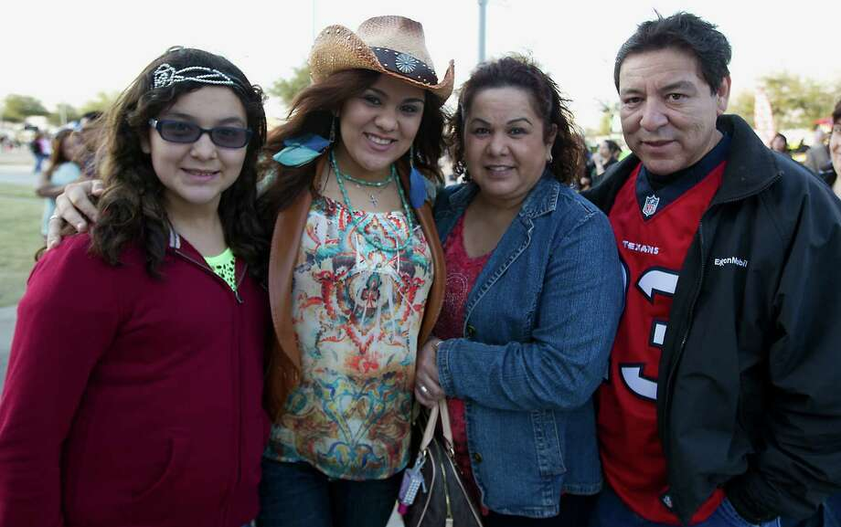 Eleven-year-old Lauren Cruz left, her fifteen-year-old sister Alyssa Cruz, mother Laura Cruz and father Robert Cruz right, arrive at Reliant Park for the RodeoHouston performance featuring Bruno Mars Thursday, March 7, 2013, in Houston. Photo: James Nielsen, Houston Chronicle / © 2013  Houston Chronicle