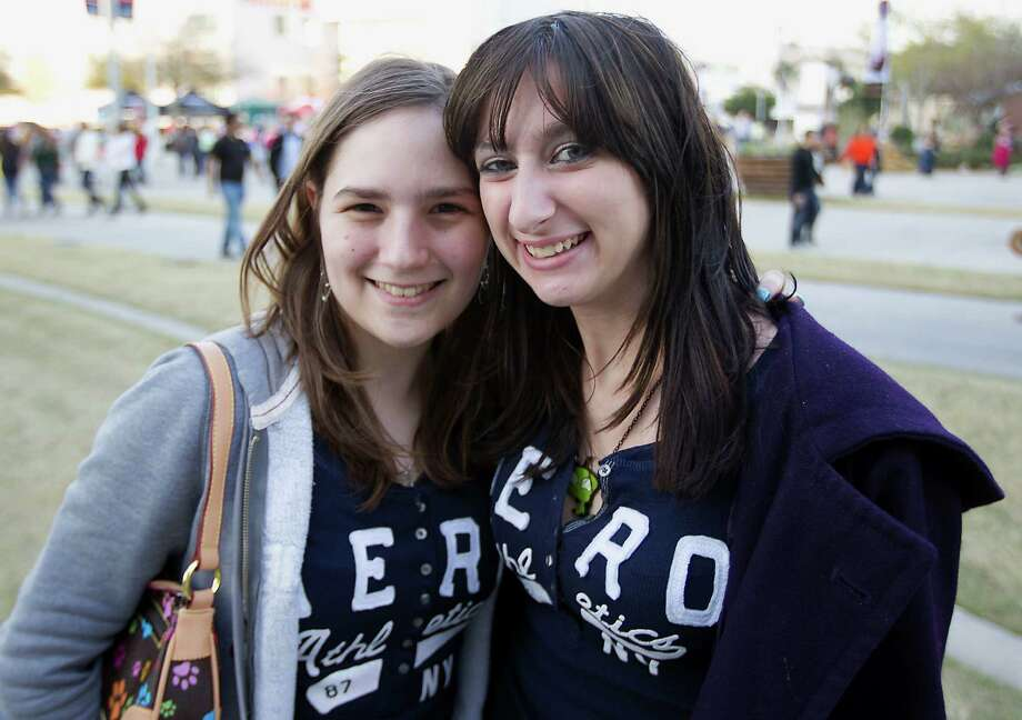 Seventeen-year-old Courtney Culpepper left, and Carla Chapman arrive at Reliant Park for the RodeoHouston performance featuring Bruno Mars Thursday, March 7, 2013, in Houston. Photo: James Nielsen, Houston Chronicle / © 2013  Houston Chronicle