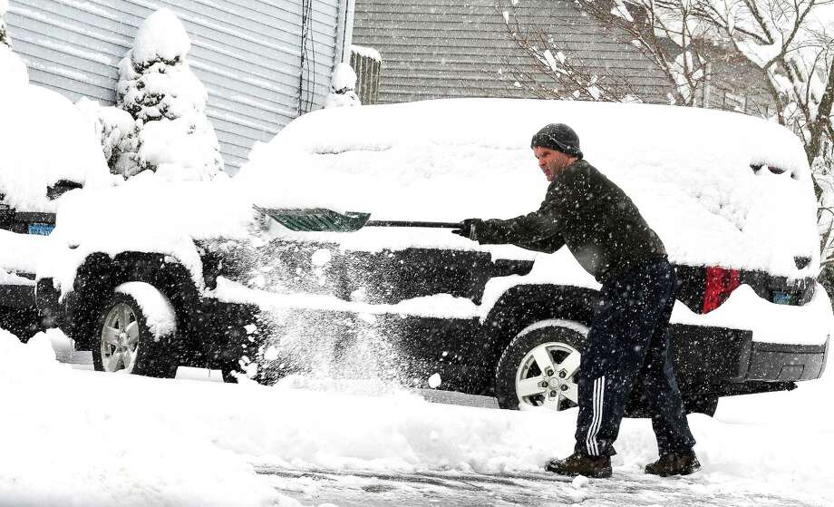 John Higgins shovels his driveway as Danbury area residents dig out during Friday morning's snow, in Conn. March 8, 2013. Photo: Michael Duffy / The News-Times