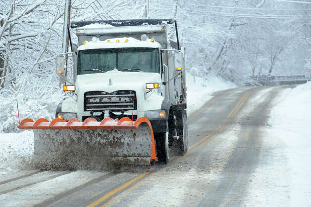 A snow plow moves up Cutspring Rd., in Stratford, Conn. March 8th, 2013. Photo: Ned Gerard