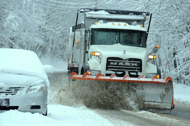A snow plow moves down Cutspring Rd., in Stratford, Conn. March 8th, 2013. Photo: Ned Gerard