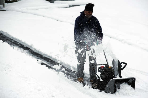Rodney Spinks uses a snow blower on the driveway of his home on Cutspring Rd., in Stratford, Conn. March 8th, 2013. Photo: Ned Gerard