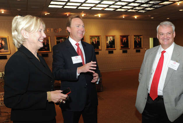 Lamar presidential candidate Gregg Lassen, center, talks with guests during a candidate reception at the school's library Thursday night. Dean College of Business University of Oklahoma  Guiseppe Barranco/The Enterprise Photo: Guiseppe Barranco, STAFF PHOTOGRAPHER / The Beaumont Enterprise