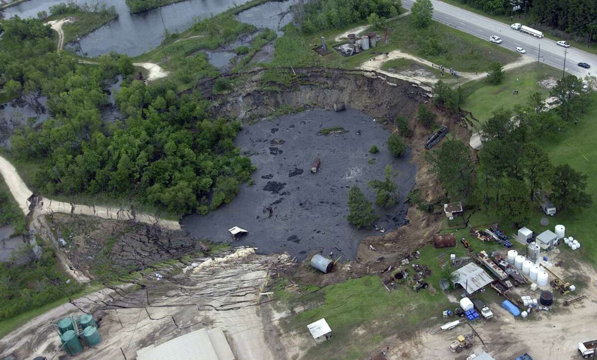 The sinkhole that formed in Daisetta May 7, 2008 in Liberty County. The hole began opening around 10 a.m. when workers with Deloach Disposal Services Co. noticed a crack in the dirt road off FM 770, upper right, leading to their business. The sinkhole grew in size, eventually swallowing a truck, saltwater storage tanks, utility poles and pipe racks. Enterprise file photo