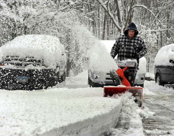 Frank Ferris blows the snow from his driveway in Brookfield, Conn. Friday, March 8, 2013. Photo: Carol Kaliff / The News-Times