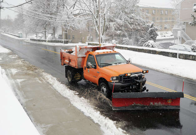 A plow clears Hamilton Avenue in Chickahominy during the snow storm that hit Greenwich, Friday morning, March 8, 2013. Photo: Bob Luckey / Greenwich Time