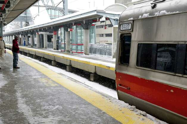 A train pulls into the train station in Stamford on Friday, March 8, 2013. Due to weather trains were running on a short delay. Photo: Lindsay Perry / Stamford Advocate