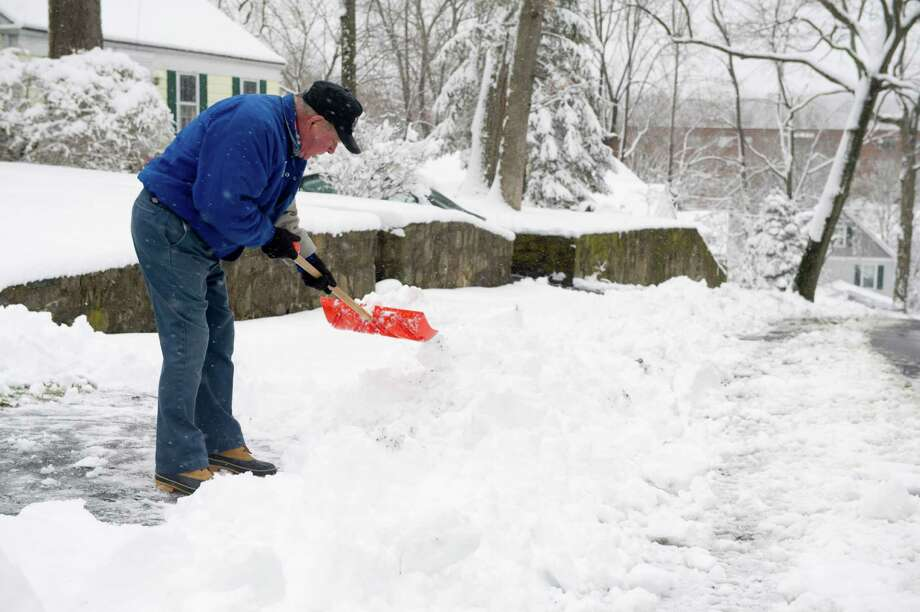 Ted Bianco shovels snow in Stamford on Friday, March 8, 2013. Photo: Lindsay Perry / Stamford Advocate