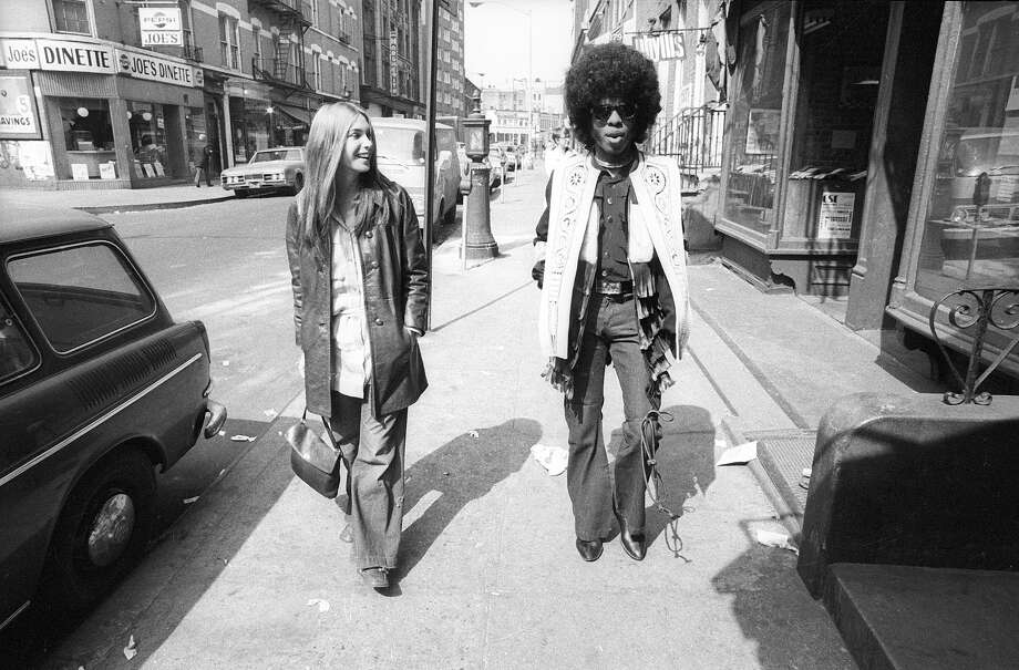Singer Sly Stone of the psychedelic soul group 'Sly And The Family Stone'  walks down the street with a woman on March 9, 1969. Photo: Michael Ochs Archives, Getty Images / Michael Ochs Archives